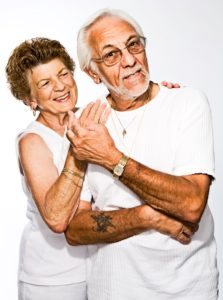 Elderly Couple Holding Hands and Showing Love