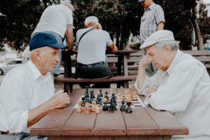 Two Leading Edge Baby Boomers Playing Chess